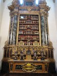 A whole cabinet of relics (bones of saints, etc.)