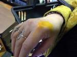 Aviva testing some yellow paint at Dick Blick