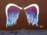 Wings painted on the side of a building