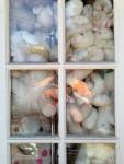 Plush toys through a French door window