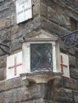 A votive on a building