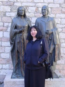 Aviva with a statue outside the church