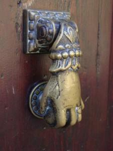 A door knocker on a door in Perugia