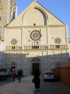 The facade of San Rufino (Aviva is taking a picture in the foreground)