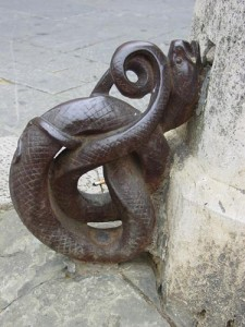 Detail of a snake attached to pillars around the Campo