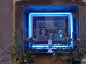 A votive image on a wall - yes, that's neon surrounding it!
