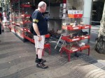 This man may be picking out dinner - those are chickens and fattened pigeons