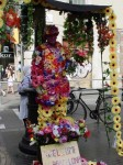 """A """"flower man"""" in the middle of the boulevard"""