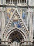View of the paintings on the facade of the Duomo