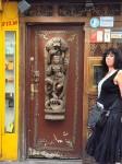 Aviva in front of an Indian restaurant