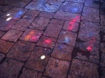 Some of the colored sunlight on the stone floor