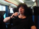 Aviva having a Coke Light on the train to Siena