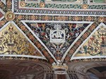 Grotesques that decorate the ceiling