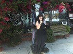 Aviva with the monster (statue) in front of Dark Delicacies