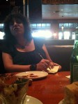 Aviva talking with me at the table