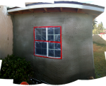 The end of the studio with the first coat of stucco applied