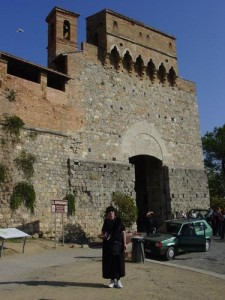 Aviva in front of the entrance to San Gimignano that we used