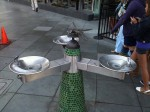 A triple water fountain with a dragonfly motif