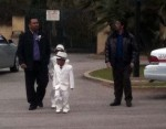Two young boys, in white suits, coming from a sweet 16 celebration at the Mission