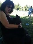 Aviva and Jett sitting in the park
