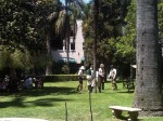People in period dress playing croquet