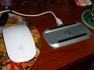 Magic Mouse next to the charging station