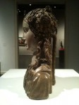 Side view of the wooden woman bust