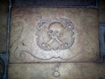 A tombstone in the floor