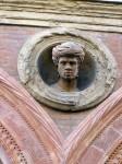 Ceramic head on facade