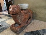 A lion sculpture with holy water