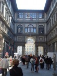 The base of the U of the Uffizi facing the Arno