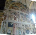Frescoes on the left of the altar