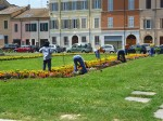 People cleaning up the gardens outside the M. A. R.