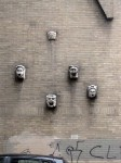 A wall with cool heads on it