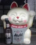 That is a lucky cat, he's got Asahi beer!