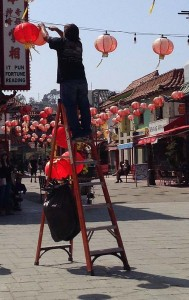 A guy repairing lanterns