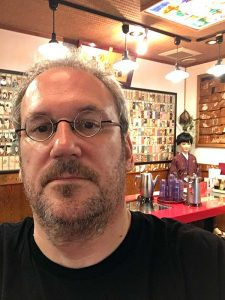Selfie in a restaurant with life-size geisha dolls